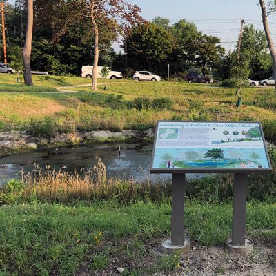 constructed wetland in milford with sign